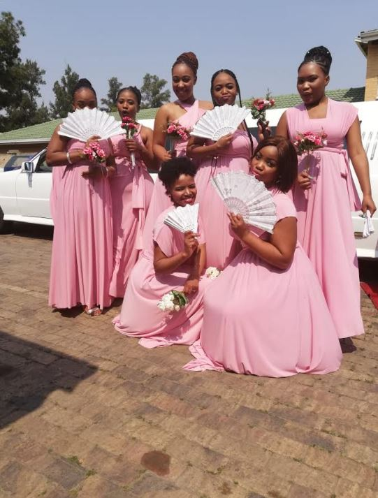 Bridesmaids in front of Limousine
